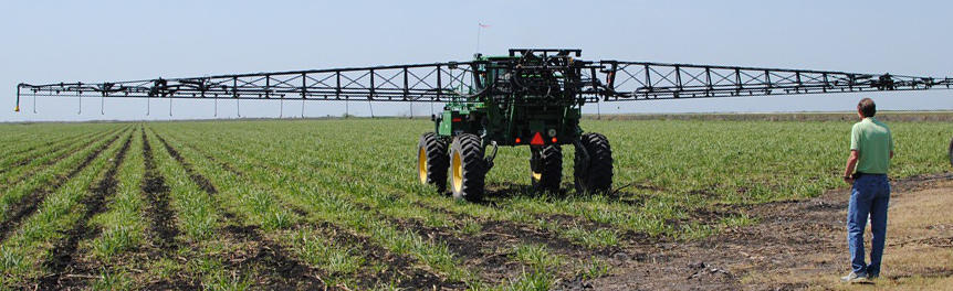 Boom sprayer in a farm field