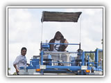 Photo: Employees operating a blue berry picker