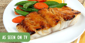 "Photo: Cooked fish and vegetables with text ""As seen on TV"""